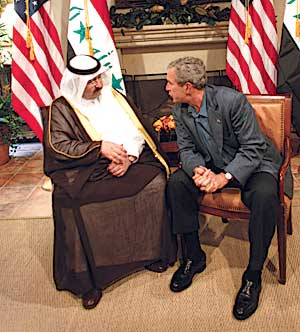 George W. Bush confers with Ghazi Mashal Ajil al-Yawer of the Iraqi interim government during the June 9, 2004 G–8 summit at Sea Island, GA