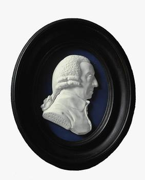An enamel paste medallion, depicting a man's head facing the right
