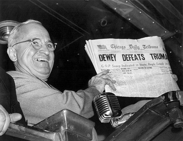 "Truman holding Chicago Tribune that says ""Dewey Defeats Truman"""