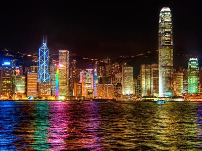 A city illuminated by colorful artificial lighting at night