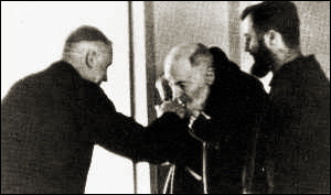Padre Pio kissing the sacred ring