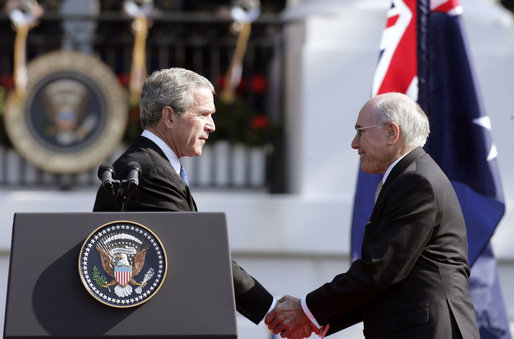 Photograph of U.S. President George W. Bush shaking hands with Australian Prime Minister John Howard, during the State Arrival Ceremony held for the Prime Minister on the South Lawn of the White House, May 2006