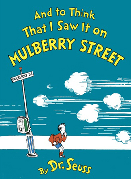 "Book cover. Against a blue background, yellow lettering at the top reads, ""And to Think That I Saw It on Mulberry Street"". At the bottom in yellow, ""by Dr. Seuss"". In the middle, a boy stands on a street, looking to the viewer's right, watching a cloud of smoke and zip lines leading off the page. To his left is a pole with a sign reading ""Mulberry Street"" on it."