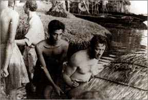 William Holden and Chandran Rutnam while shooting The Bridge on the River Kwai