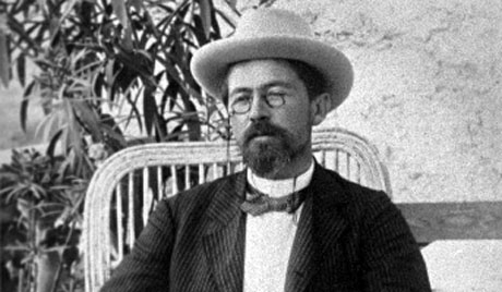 Anton Chekhov with pince-nez, hat and bow-tie