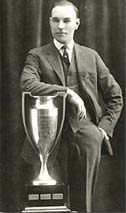 Man in suit with trophy