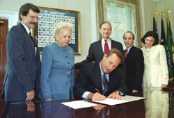 Signing new bills 1999
