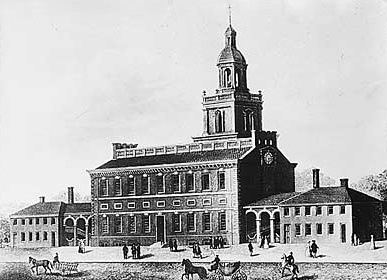 Drawing of a handsome building with a bell tower and a wing on each side. Horse-drawn carriages are seen in the street.