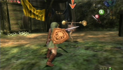 A boy in a green tunic holds a shield while swinging his sword towards an enemy.