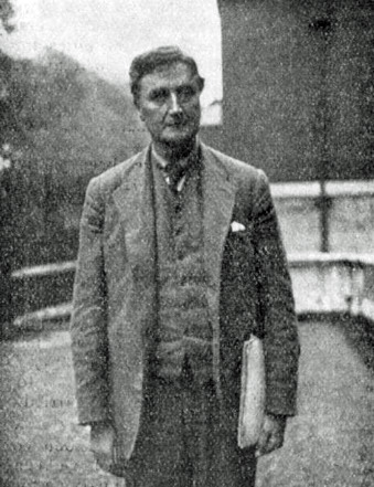 Smartly dressed European man looking towards camera