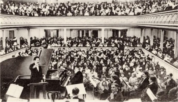 interior of packed concert hall during a concert