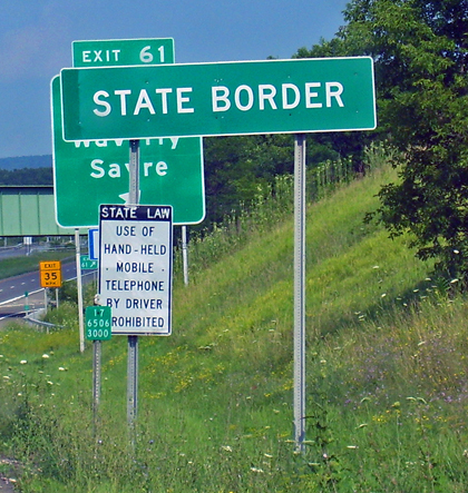 State border sign on NY 17