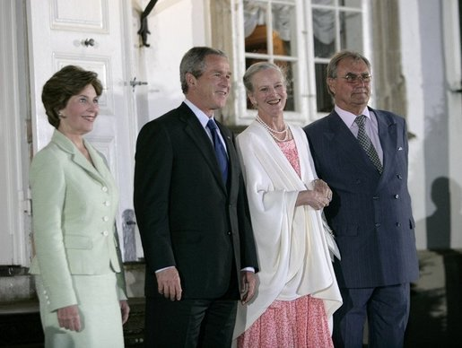 Queen Margrethe II and Prince Henrik of Denmark welcome George W. Bush and Laura Bush