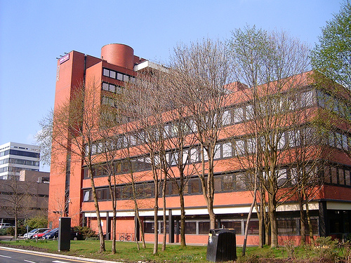 Manchester Business School: large, red-brick building with trees in front