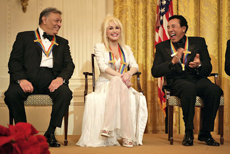 Zubin Mehta laughs with singers Dolly Parton and William Smokey Robinson during a reception for the Kennedy Center honorees