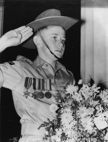 Soldier's son wearing his father's medals on Anzac Day, Brisbane, 1954 (4536575731)