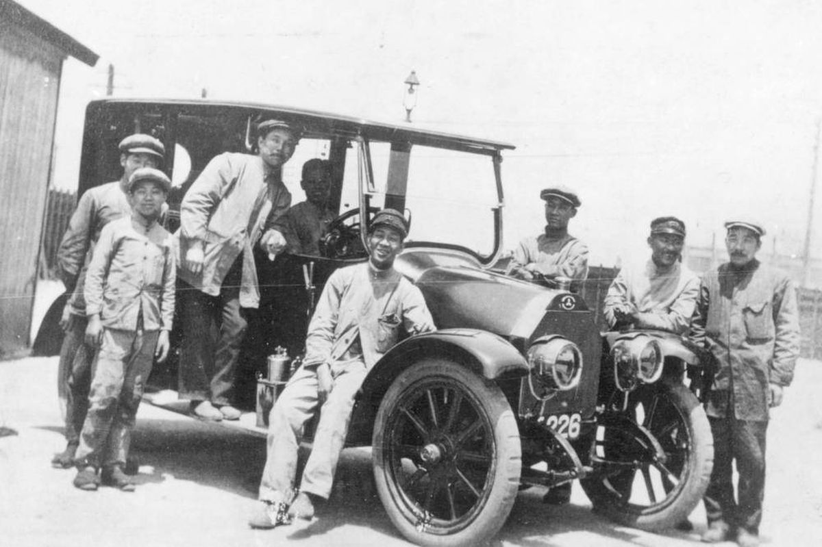 Mitsubishi model a and workers