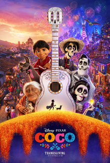 "Theatrical release poster depicting the characters Coco, Dante the dog, Miguel, Héctor, Ernesto, and Imelda when viewing clockwise from the bottom left around the white Day of the Dead-styled guitar. The guitar has a calavera-styled headstock with a small black silhouette of Miguel, who is carrying a guitar, and Dante (a dog) at the bottom. The neck of the guitar splits the background with their village during the day on the left and at night with fireworks on the right. The film's logo is visible below the poster with the ""Thanksgiving"" release date."