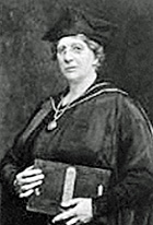 head and shoulders image of a woman in academic cap and gown