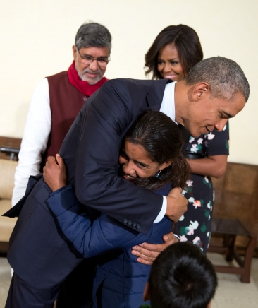 President Obama greets a young girl who was the guest of Nobel Peace Prize winner Kailash Satyarthi in New Delhi