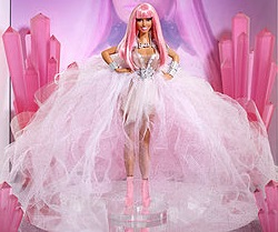 A plastic doll on display wearing a gauzy, pale gown with a neon pink wig and matching stilettos.