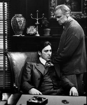 A screenshot of Michael and Vito Corleone during The Godfather