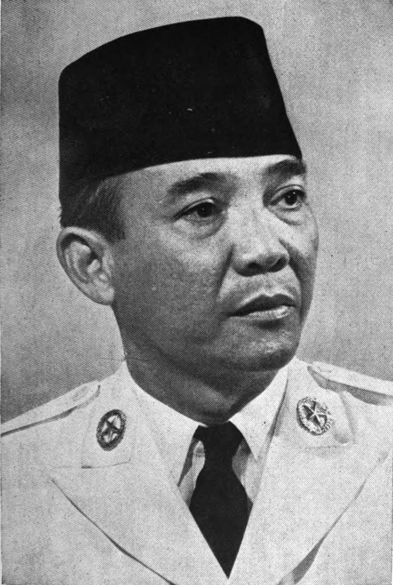 A black-and-white three-quarters view of Sukarno's face