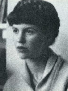 A black-and-white photo of a woman with her hair up, looking to the left of the camera lens