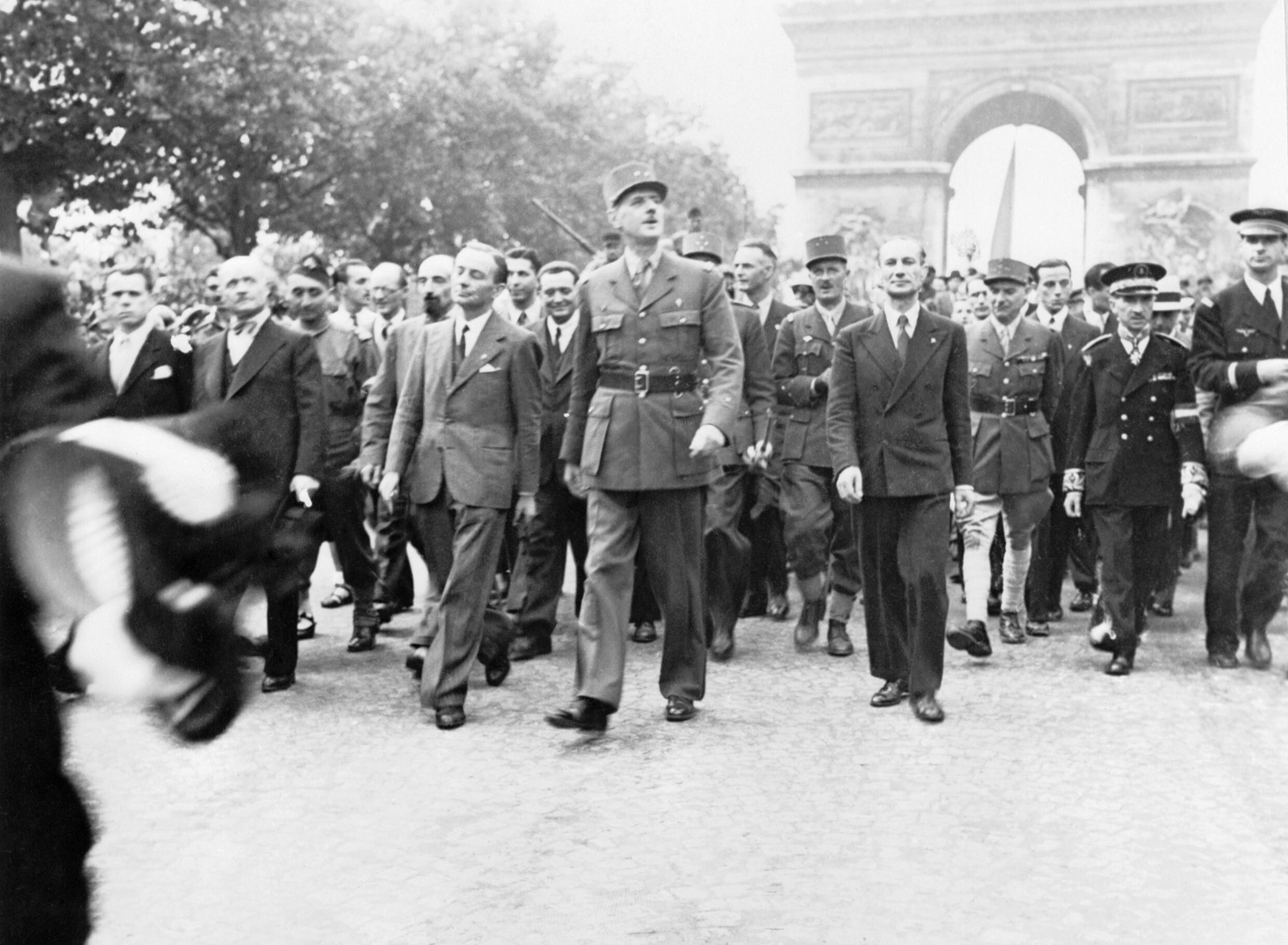 General Charles de Gaulle and his entourage set off from the Arc de Triumphe down the Champs Elysees