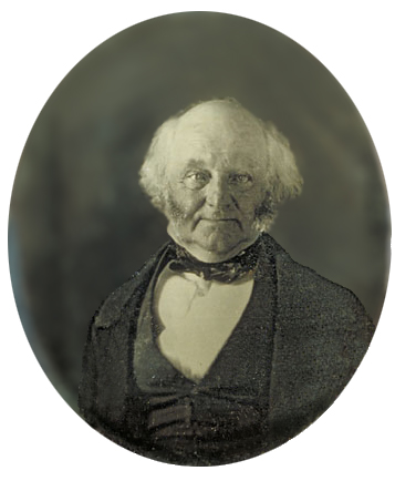 Half-length photographic portrait of an elderly, balding man dressed in a dark coat, vest and cravat