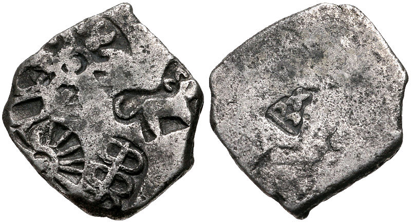Mauryan coin with arched hill symbol on reverse
