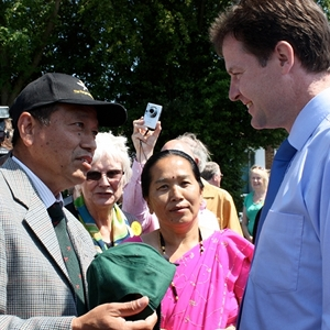 Nick Clegg being presented a Gurkha Hat, by a Gurkha veteran