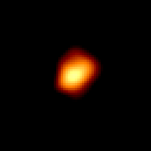 Grainy irregular shaped yellow spot with red rim on a black background