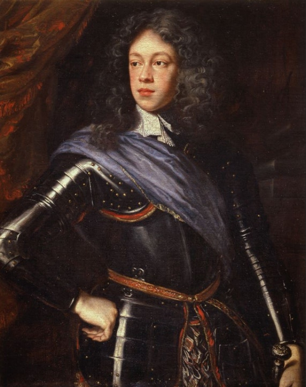 Formal portrait of Mary's father as a young man. He has long bushy hair and a fleshy face, and wears a black suit of armor with a brown shoulder sash.