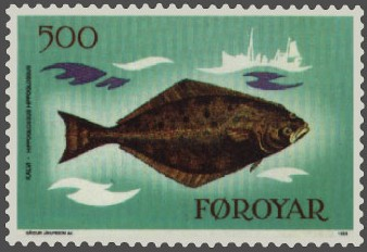 Photo of a stamp displaying a painting of the brown side of a halibut