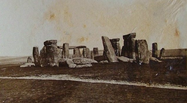 old photograph of stonehenge with toppled stones