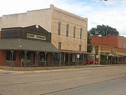 A view of downtown Claude, Texas, on U.S. Highway 287 with the historic pharmacy building on the left