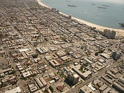 The Alamitos Beach neighborhood of Long Beach, California, looking southeast. Alamitos Avenue runs left to right across the center of the photo; Alamitos Beach is located above it, with the East Village below. 4th Street cuts from the top left corner to the bottom center; Alamitos Beach is to the right of it.