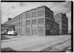 VIEW NORTHEAST-ELMER STREET; CENTER-BUILDING 102-ELMER STREET ROPE SHOP (1917); RIGHT-BUILDING 101-CLARK STREET ROPE SHOP (1917) - John A. Roebling's Sons Company and American HAER NJ,11-TRET,33-66.tif