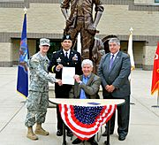 Gov. Rick Snyder signs National Guard tuition assistance bill (14426159330)