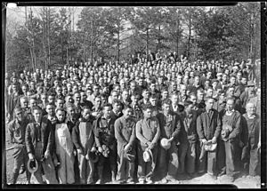 """A group of several hundred workers at Norris Dam construction camp site during noon hour."" - NARA - 532734"