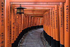 Torii path with lantern at Fushimi Inari Taisha Shrine, Kyoto, Japan