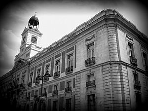 Black and white photograph taken at Puerta del Sol in Madrid