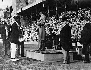 Duke Kahanamoku accepting the Olympic Gold Medal from King Gustav, Stockholm, Sweden 1912