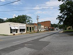 A part of Main Street looking East while standing in front of the courthouse.