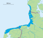 A map showing the coast of the Netherlands, Germany and Denmark. The land is green, the Wadden Sea is dark blue and the ocean is light blue.