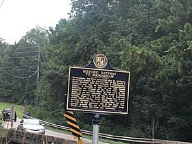 Historic marker and commemorative plaque in Brock gap, Hoover, Birmingham, Alabama, USA.jpg