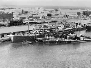 USS Holland (AS-3) tending submarines at Fremantle, Australia, on 5 March 1942 (AWM 302625)