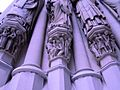 Saint John the Divine Cathedral (figures carved into columns, exterior, detail)