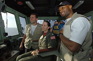 US Navy 050212-N-8629M-160 Lt. Allison Johnson, center, poses with New York Giants quarterback Kurt Warner, left, and wide receiver Amani Toomer during their visit aboard the Military Sealift Command (MSC) hospital ship USNS Me